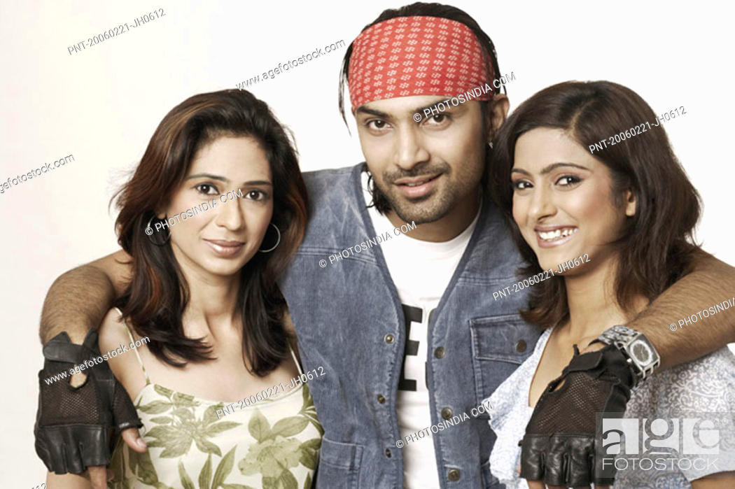 Stock Photo: Portrait of a young man with his arms around two young women.