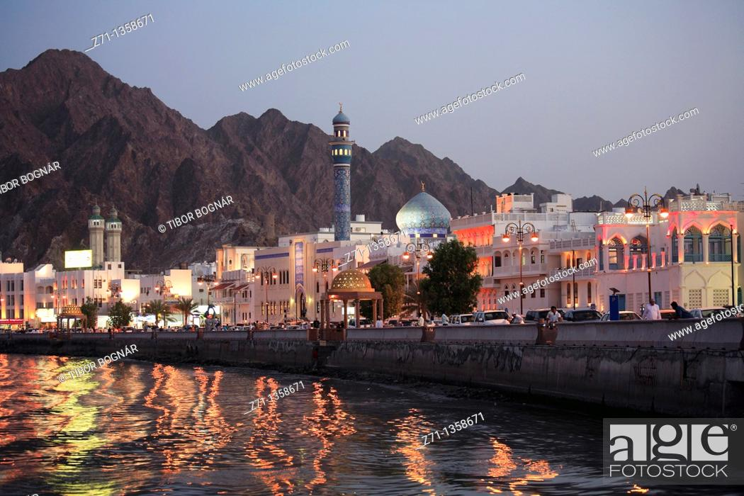 Stock Photo: Oman, Muscat, Mutrah, skyline at dusk.