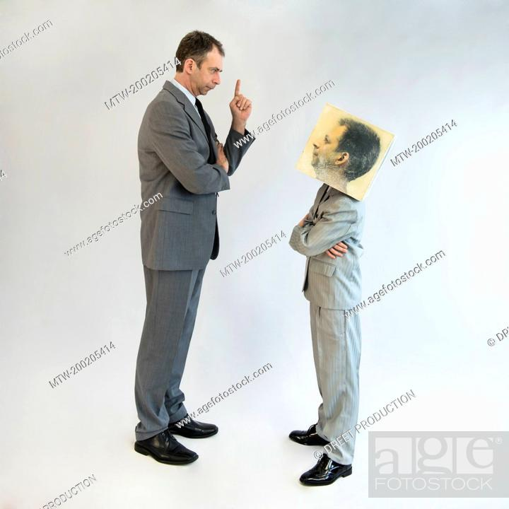 Imagen: Businessman scolding boy wearing mask.