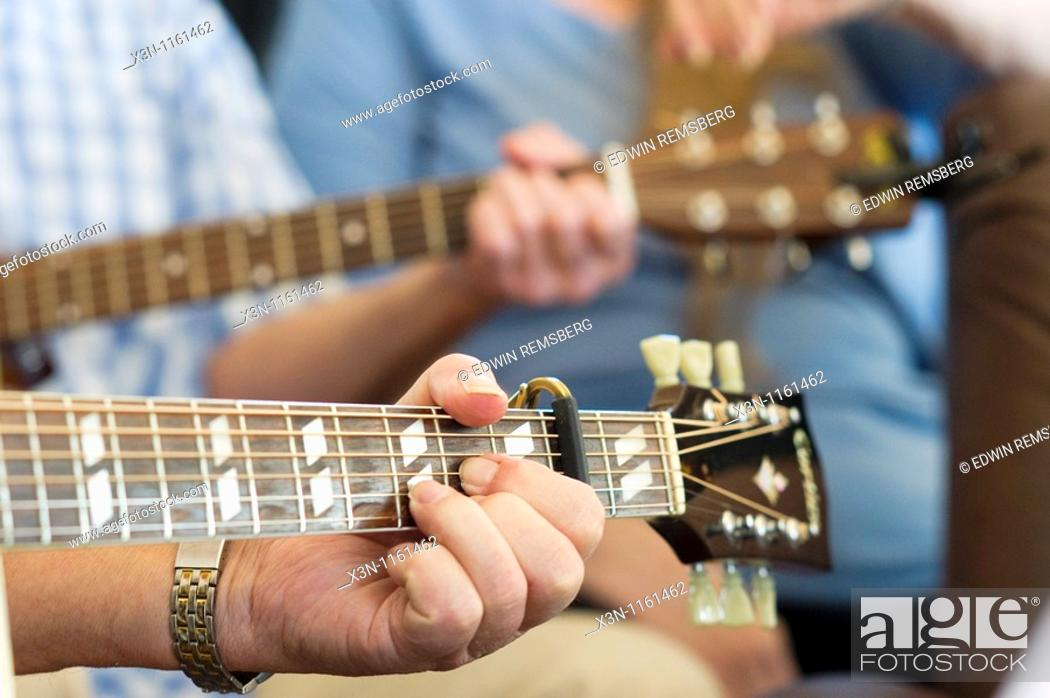 Hands on guitar chords, bluegrass music, Stock Photo, Picture And ...