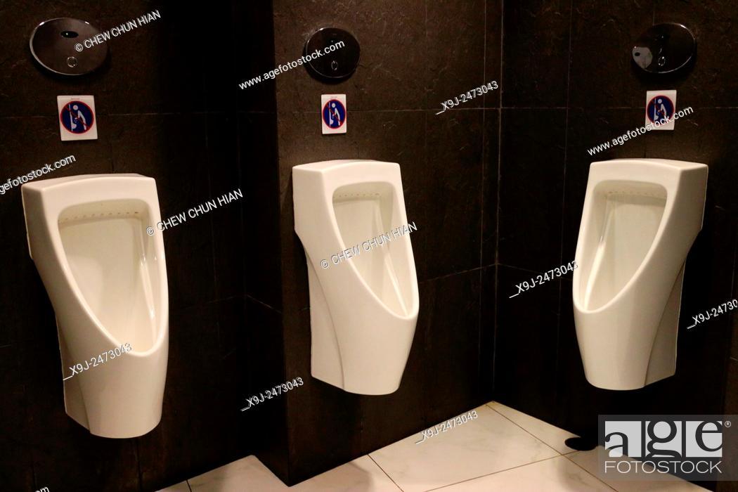 Stock Photo: Mens public toilet.