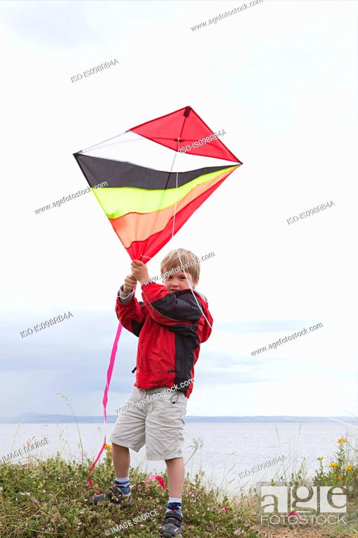 Stock Photo: Boy with a kite.