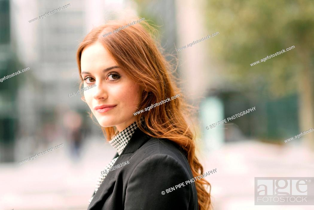 Stock Photo: Portrait of businesswoman looking at camera.