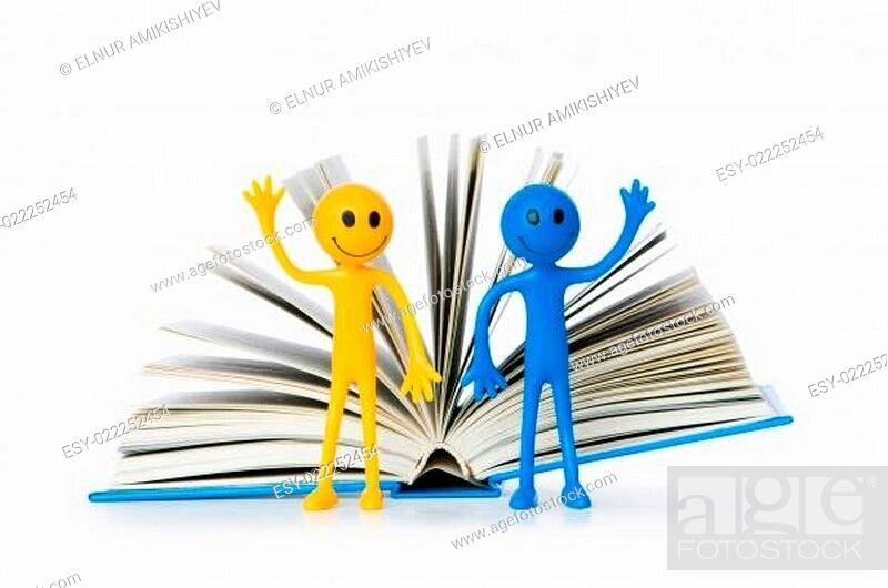 Imagen: Education concept - books and smilie on white.