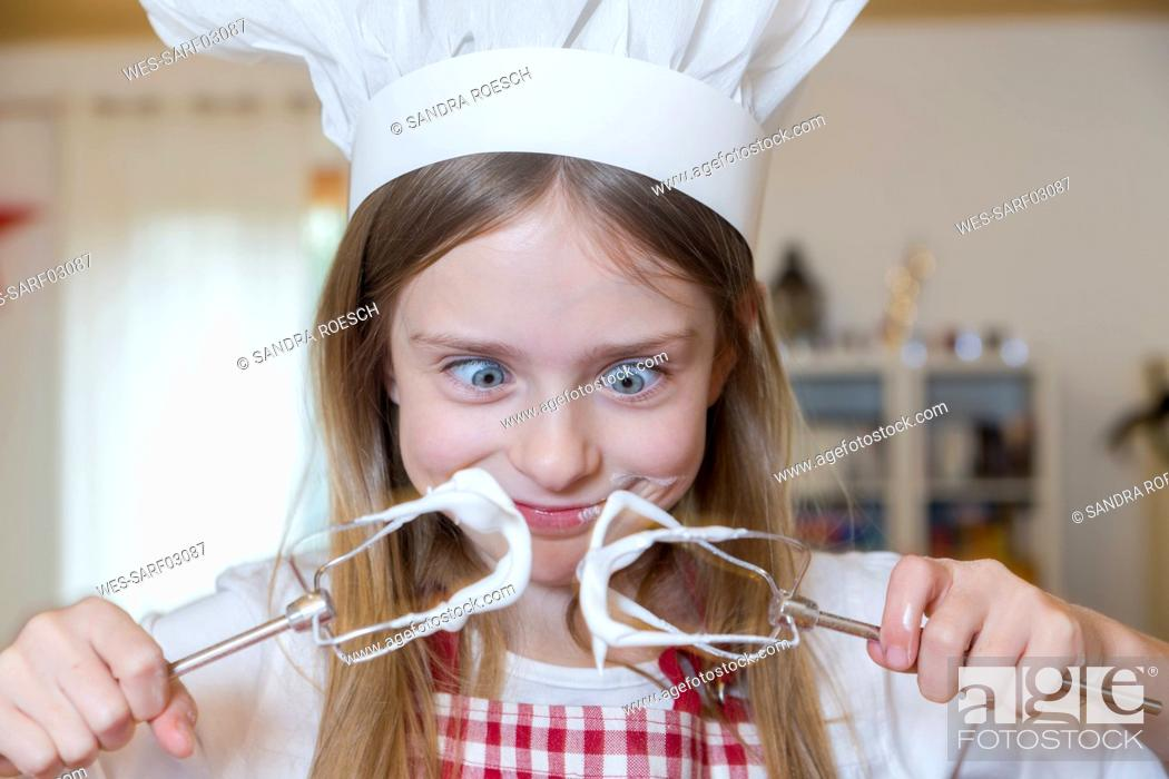Stock Photo: Portrait of staring girl with stirrer and chef's hat.