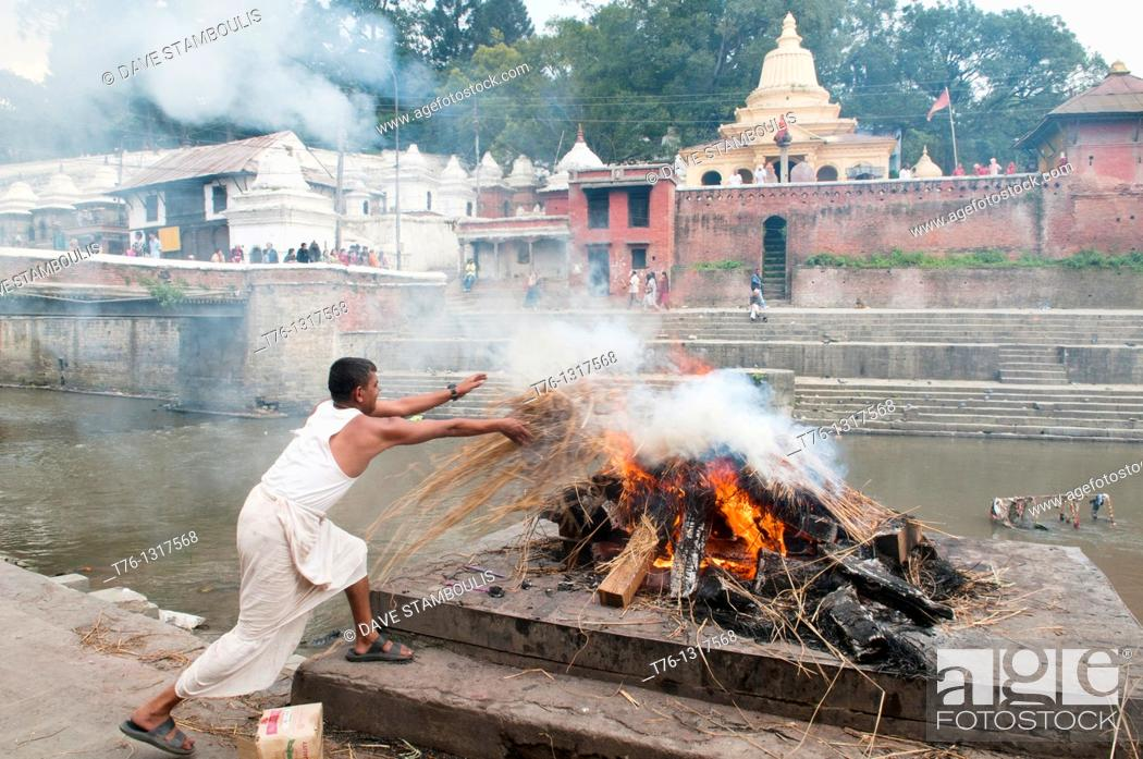 Stock Photo: cremation ceremony on the Bagmati River at the Pahsupatinath Temple in Kathmandu, Nepal.