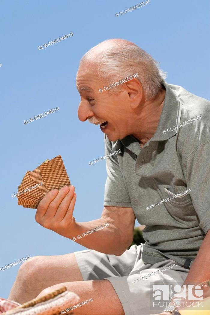 Stock Photo: Close-up of a senior man playing cards.