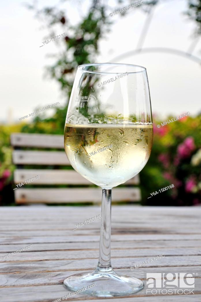 Stock Photo: Glass of white wine on wooden table in Heuriger Grinzing Vienna.