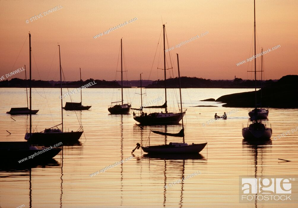 Stock Photo: Sunset harbor with rowboat & sailboats, Southport, Fairfield County, Connecticut, USA.
