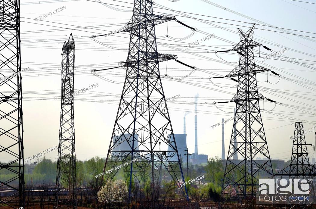 Stock Photo: Chinese coal powered electricity generating power station on north side of city of Taiyuan, China. Cooling towers and grid pylons.