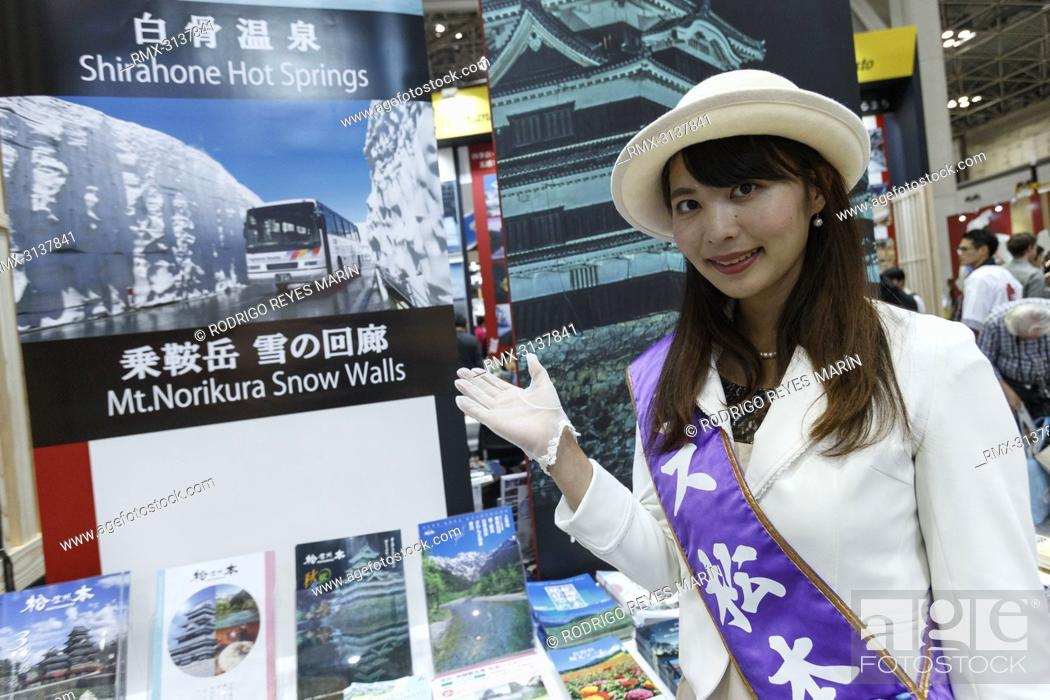 Exhibition Booth Assistant : September tokyo japan a booth assistant poses for a