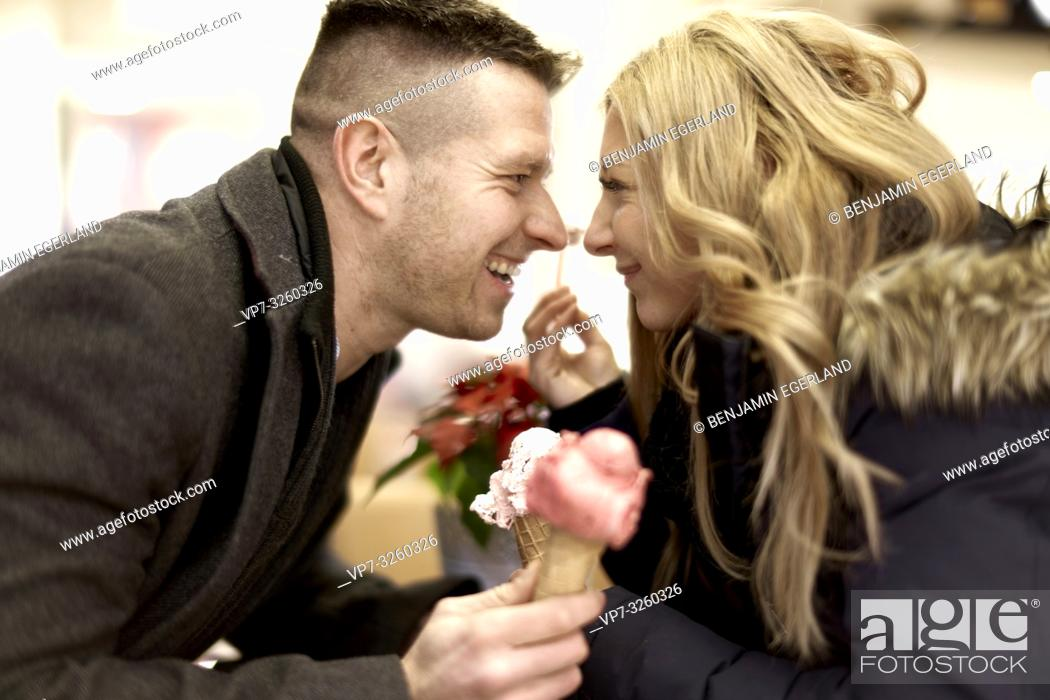 Imagen: couple eating ice cream, looking at each other, in Cottbus, Brandenburg, Germany.