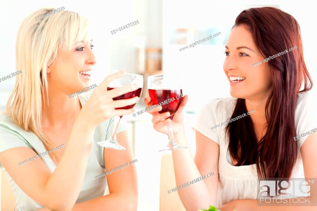 Stock Photo: Joyful women toasting with wine.