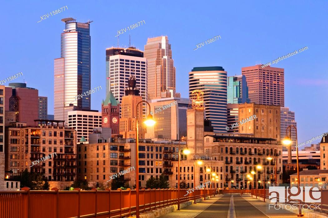 Stock Photo: Minneapolis skyline at dawn as seen from the Stone Arch Bridge   The Stone Arch Bridge is a former railroad bridge crossing the Mississippi River at Saint.