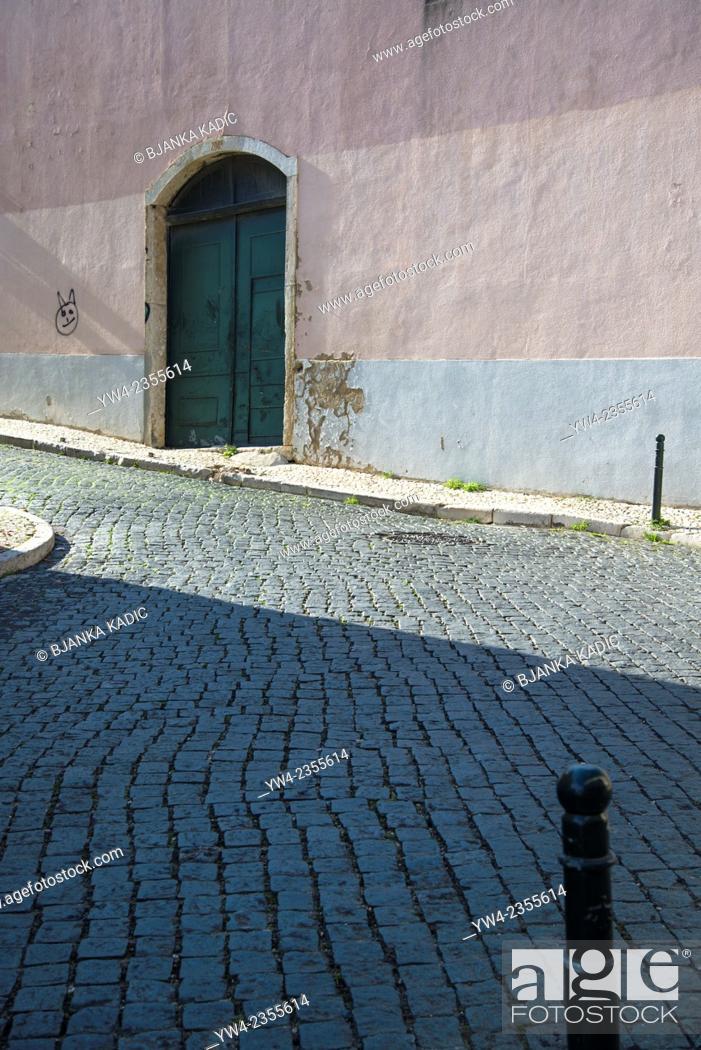 Stock Photo: Wall and door, Alfama district, Lisbon, Portugal.