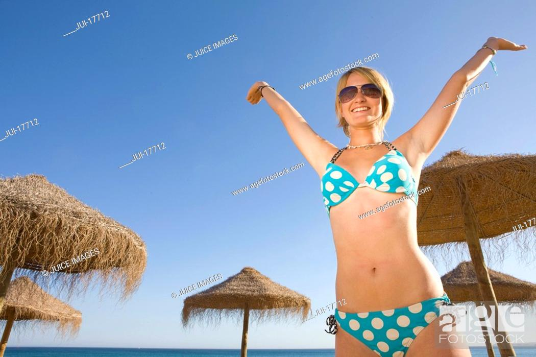 Stock Photo: Stylish teenage girl posing on beach.