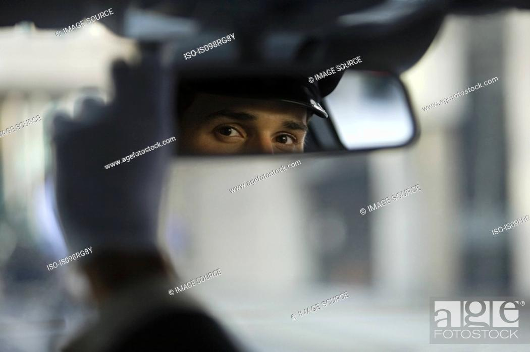 Stock Photo: Chauffeur looking in the rear view mirror.