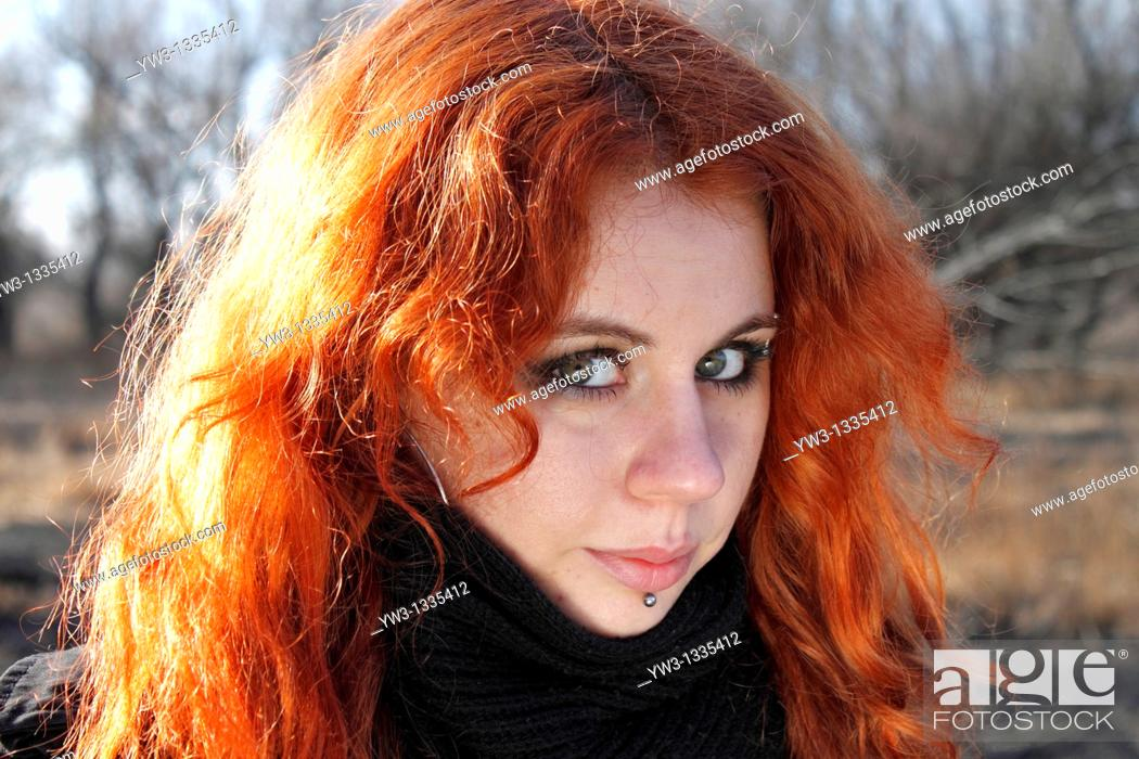 Stock Photo: red haired girl outdoors headshot.
