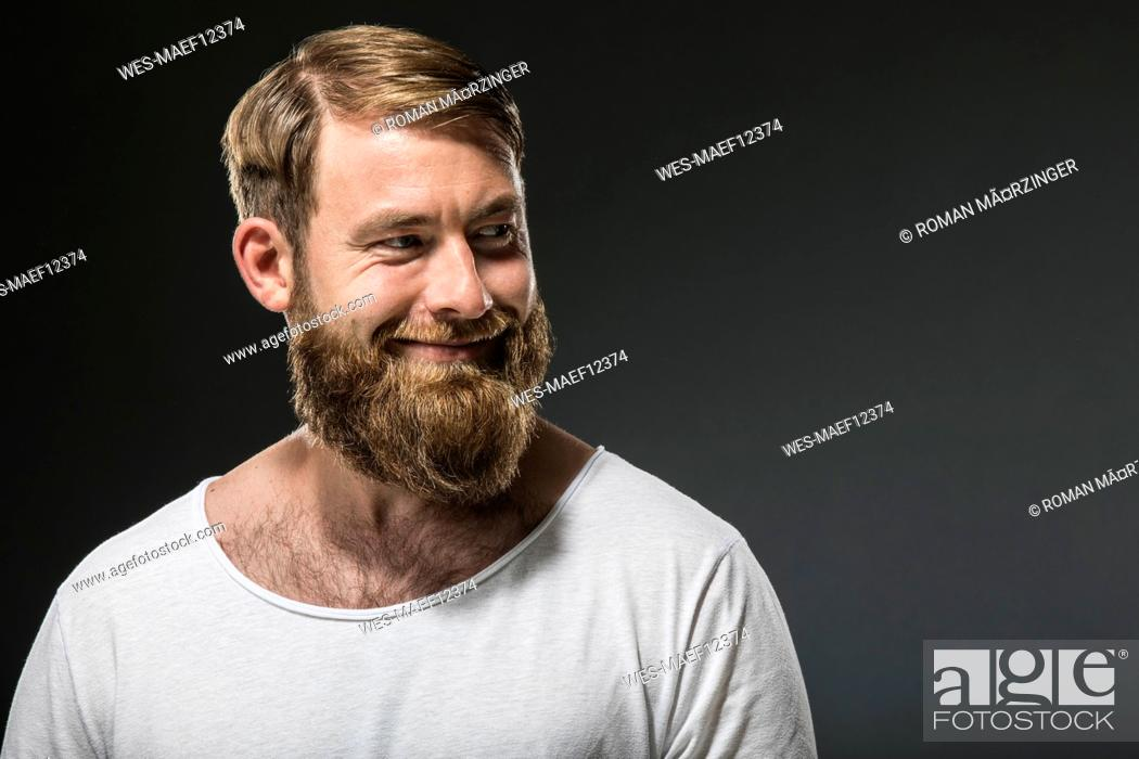 Stock Photo: Portrait of smiling man with full beard.