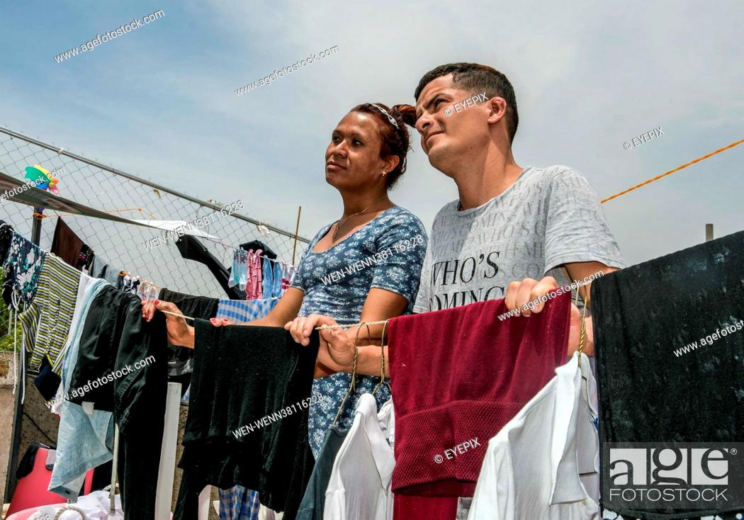 Stock Photo: Migrants Transgender couple from Honduras, Alejandra and David, who fled their native country due to violence against the LGBTIQ community on their journey to.