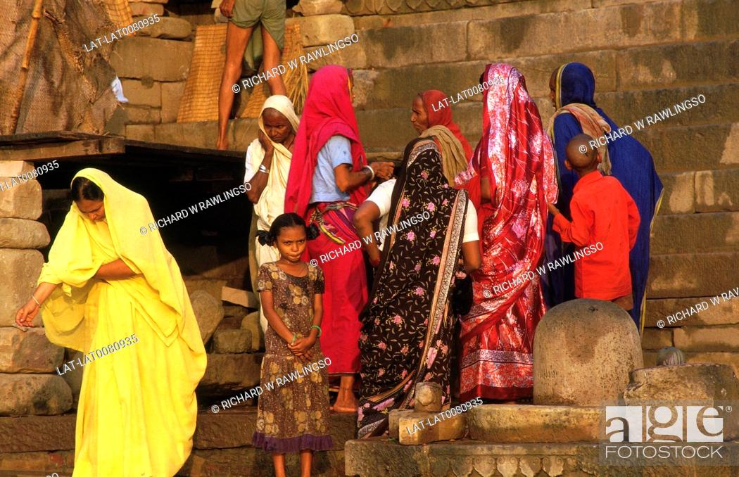 Steps by water  Sacred river Ganges  Hindu women at morning