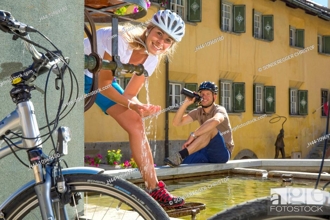 Stock Photo: Engadin, Engadine, Zuoz, GR, canton, Graubünden, Grisons, Upper Engadine, summer, village, bicycle, bicycles, bike, riding a bicycle, summer sport, Flyer, eBike.