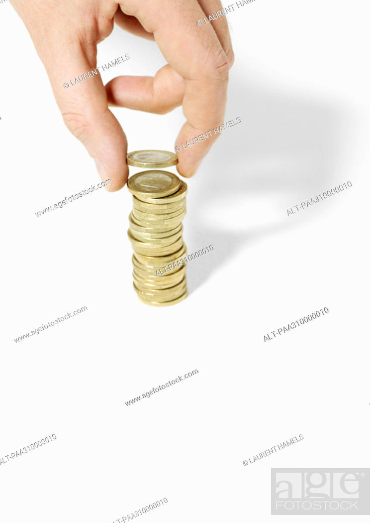 Stock Photo: Hand stacking coins.