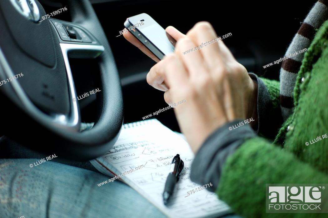 Stock Photo: Using smartphone in car.