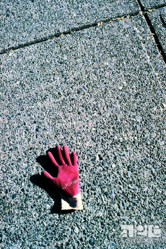 Stock Photo: Pink Glove on Sidewalk.