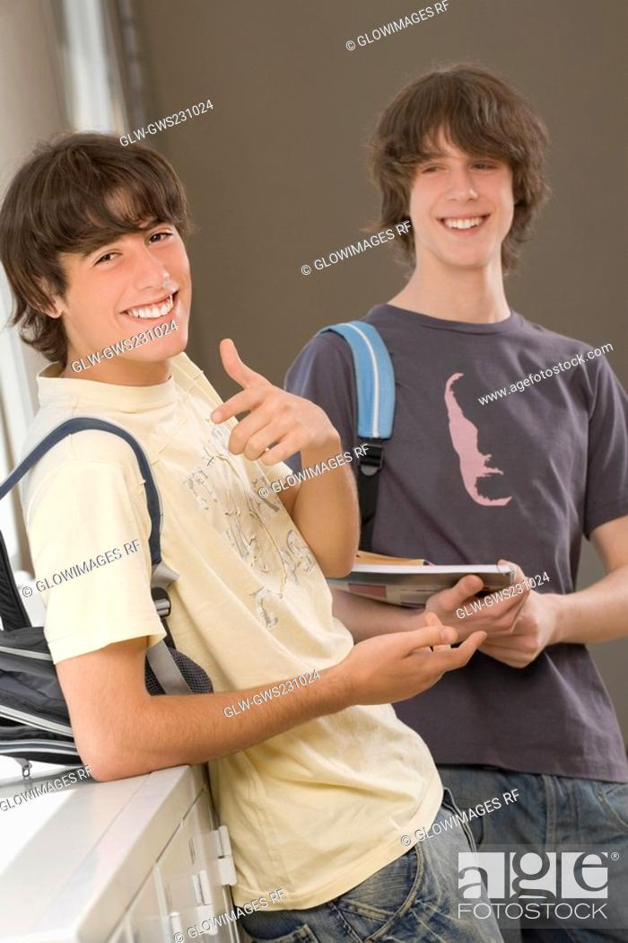 Stock Photo: Portrait of a teenage boy and a young man smiling together.