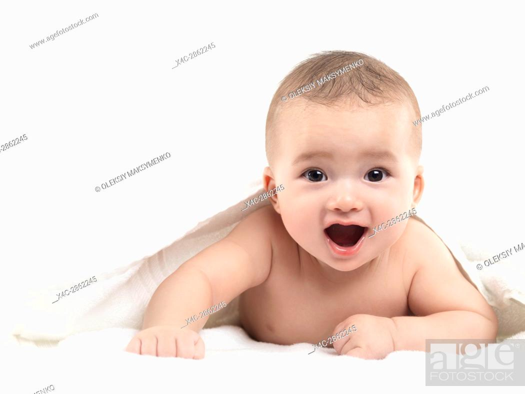 Stock Photo: Portrait of an extremely cute little baby boy with a joyous excited expression on his face looking at the camera. Four month old child.