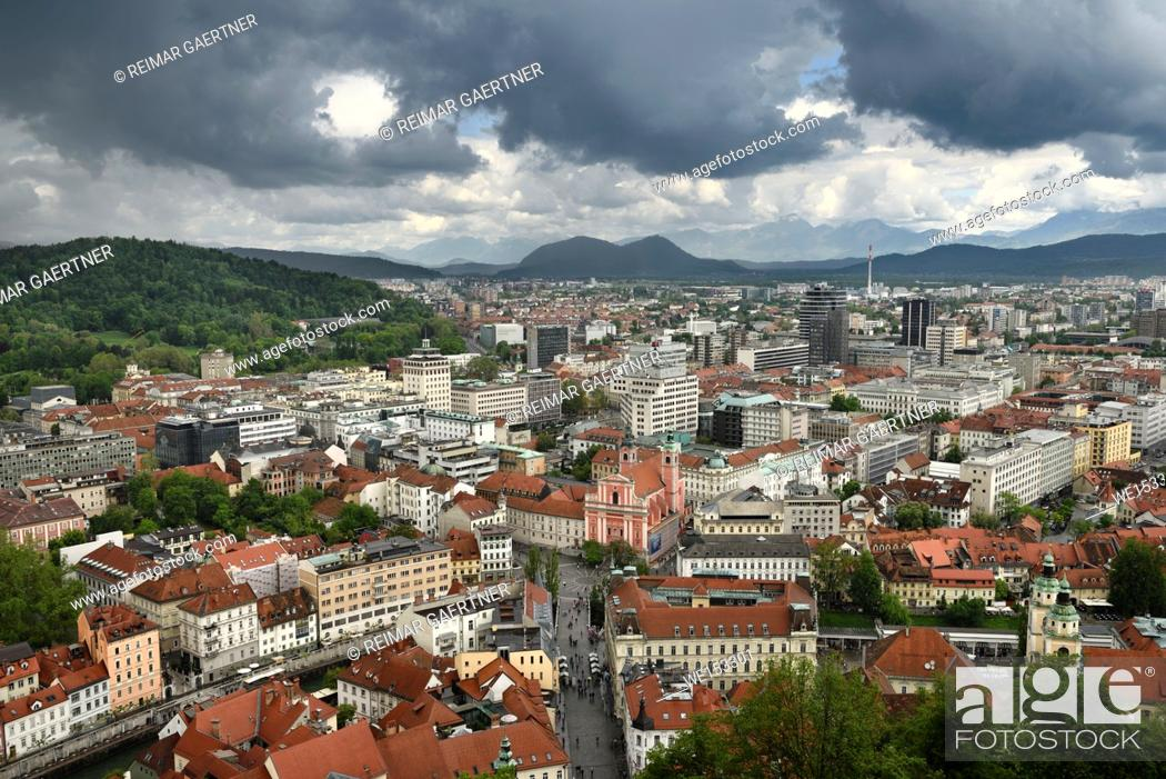 Stock Photo: Ljubljana Slovenia with Karawanks Kamnik Savinja limestone Alps and pink Franciscan Church of the Annunciation Preseren Square and Ljubljanica canal.