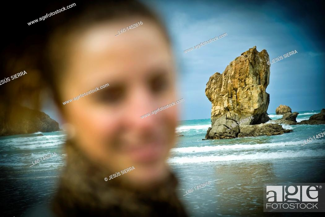 Stock Photo: Girl in Aguilar's beach, Asturias, Spain.