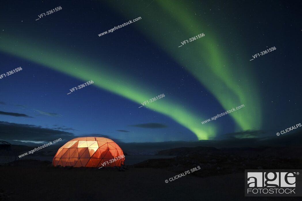 Stock Photo: Illuminated tent with northern Lights,Qaleraliq Glacier Camp, Greenland.