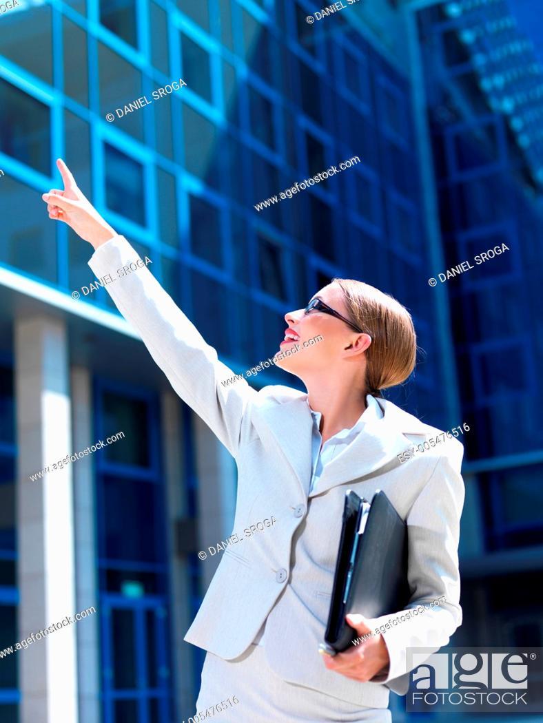 Stock Photo: Beautiful business woman standing outdoor modern building.