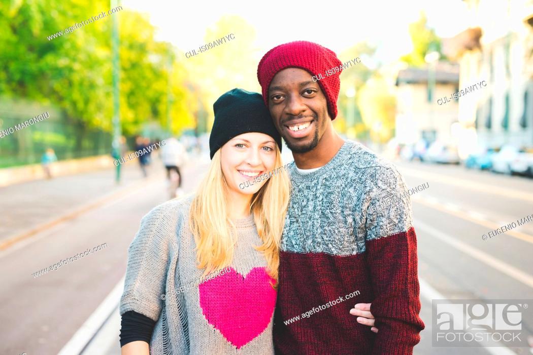 Stock Photo: Couple posing on street.