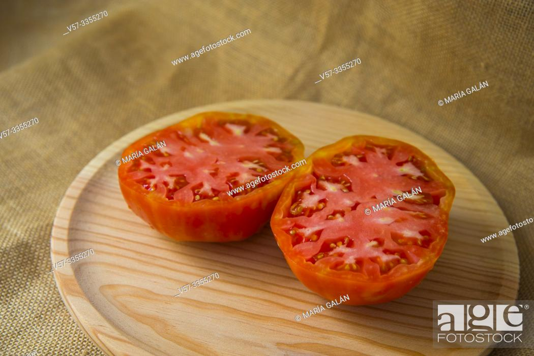 Stock Photo: Big tomato cut in two halves. Still life.