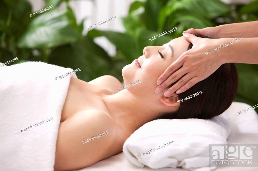 Stock Photo: Beauty Treatment, Woman lying and enjoying massaging.