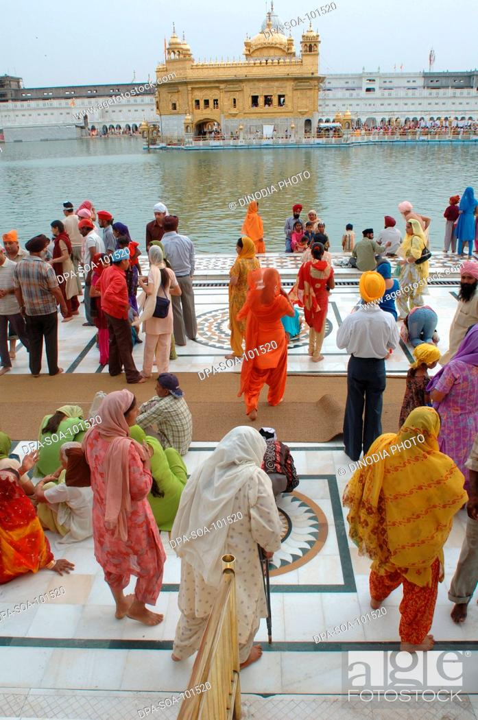 Stock Photo: Sikh devotees walks around Golden temple ; Amritsar ; Punjab ; India.