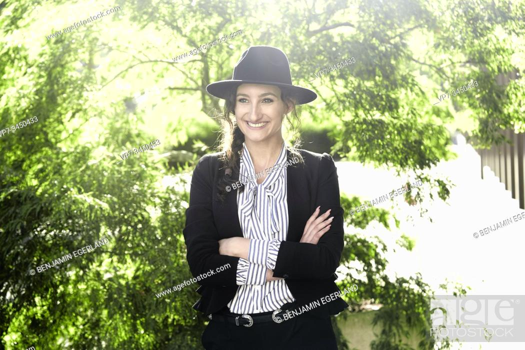 Stock Photo: Portrait of woman wearing hat. Munich, Germany.