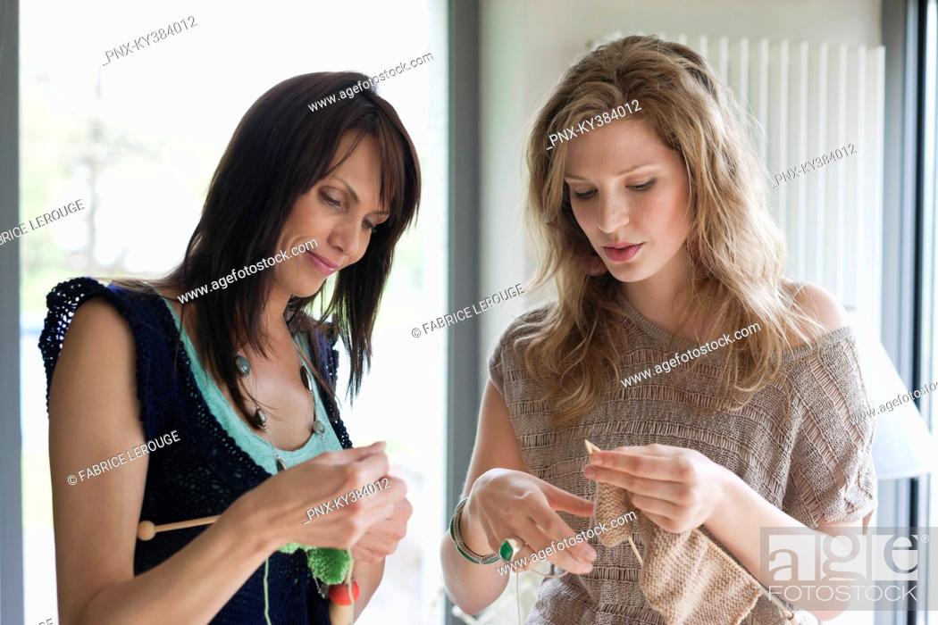 Stock Photo: Two women knitting.