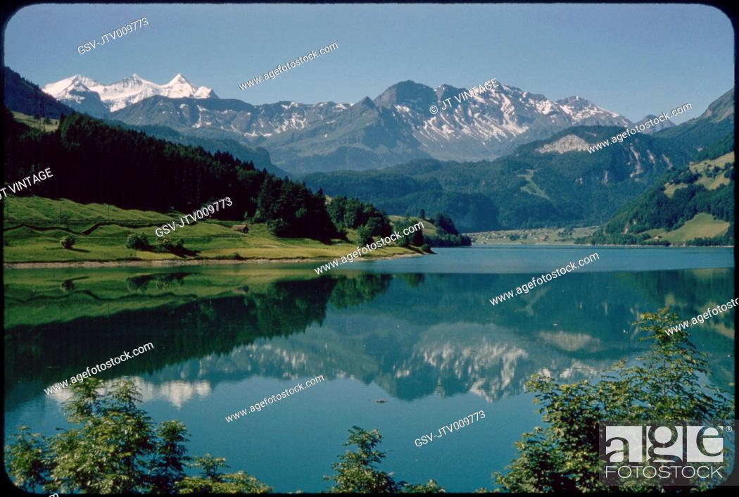 Imagen: Reflection of Kaisershuhl Mountains in Lake Lungern, Obwalden, Switzerland, 1964.