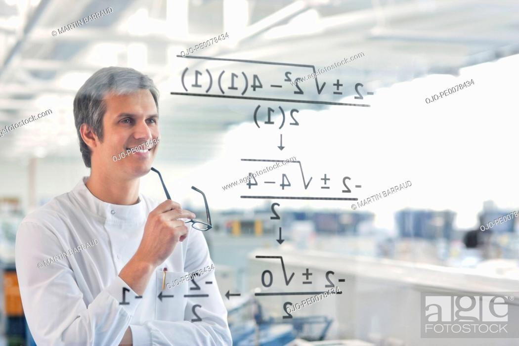 Stock Photo: Scientist using touch screen in lab.