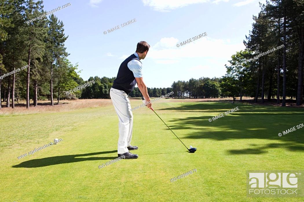 Stock Photo: Male golfer on the fairway.
