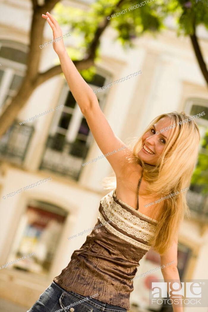 Stock Photo: Young woman waving.