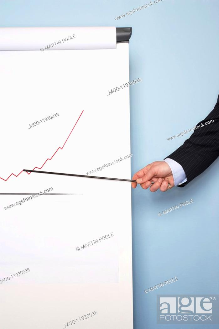 Stock Photo: Businessman pointing at graph on easel close-up of hand.