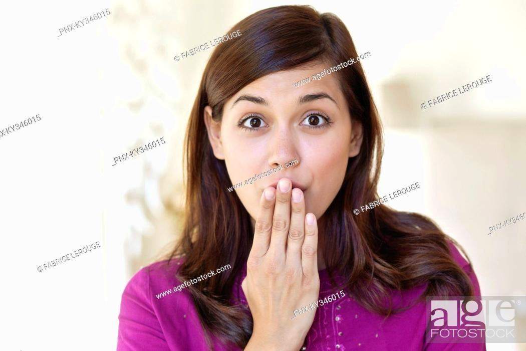 Stock Photo: Portrait of a woman looking surprised.