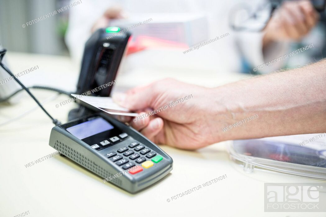 Stock Photo: Cashless payment at shop counter.