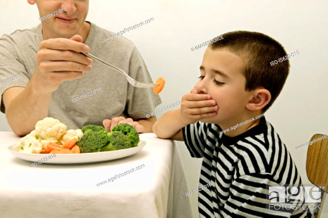 Stock Photo: Boy rejecting vegetables.