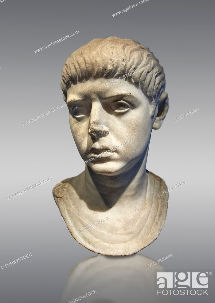 Stock Photo: Roman portrait bust of a young man from the reign of Nero, 54-68 AD. This portrait can be dated to the reign of Nero due to the facial features and hair style.